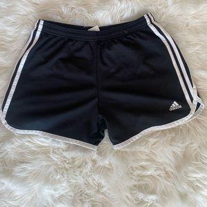 Women's black Adidas workout shorts.